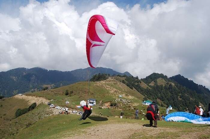 Tourists try paragliding at Bir Biling in Himachal Pradesh