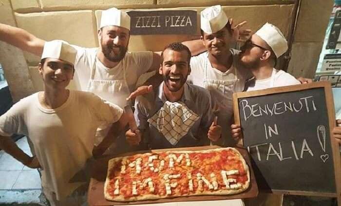 Jonathan Quiñonez with a pizza saying i am fine