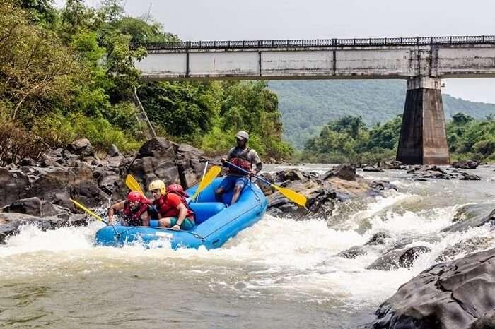 A group of adventure seekers rafting in Goa