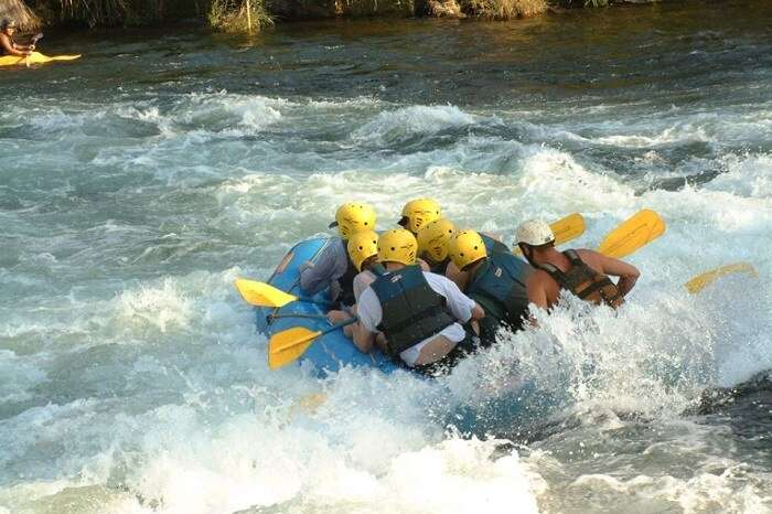 A group of adventure seekers indulge in water rafting in Goa