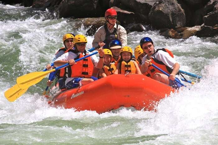 A group of foreigners indulge in white water rafting in Goa