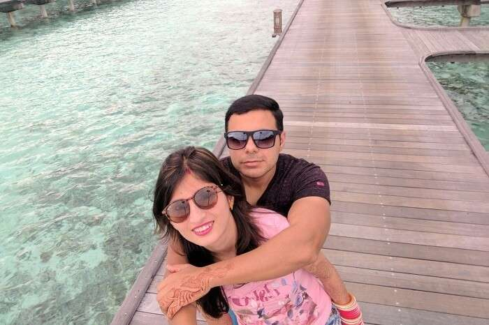 Couple taking selfie near water villas