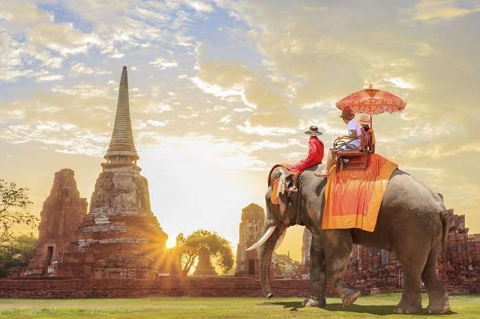 Tourists take an elephant ride in Thailand