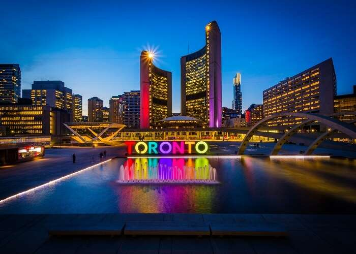View of Nathan Phillips Square and Toronto Sign in downtown at night, in Toronto