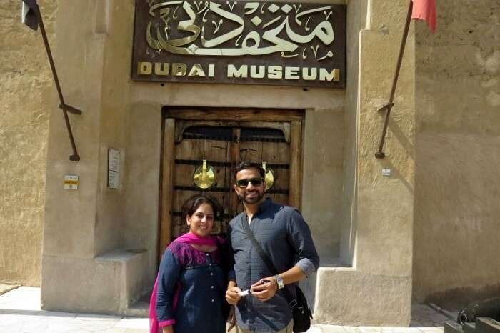 couple traveling together near dubai museum
