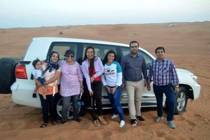 family enjoying desert safari together in Dubai