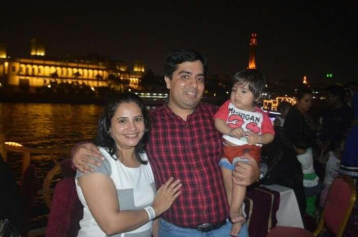 family enjoying dinner on cruise in Dubai