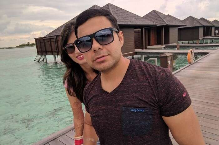 couple enjoying near water villas