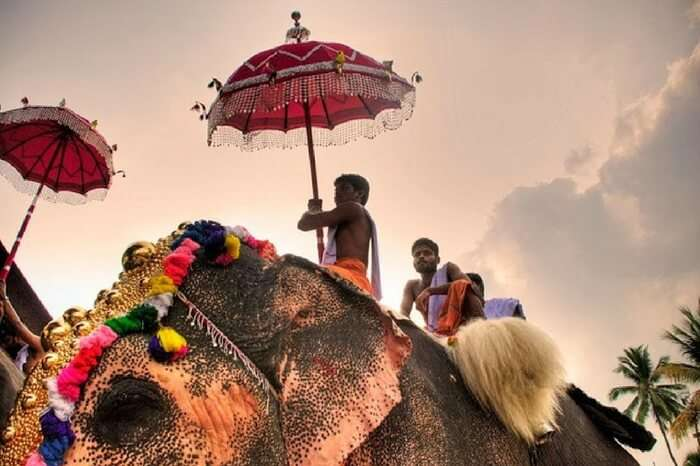 Tourists riding an elephant during Hampi Utsav