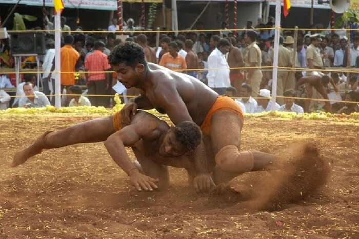 Wrestling match in progress at Hampi Utsav