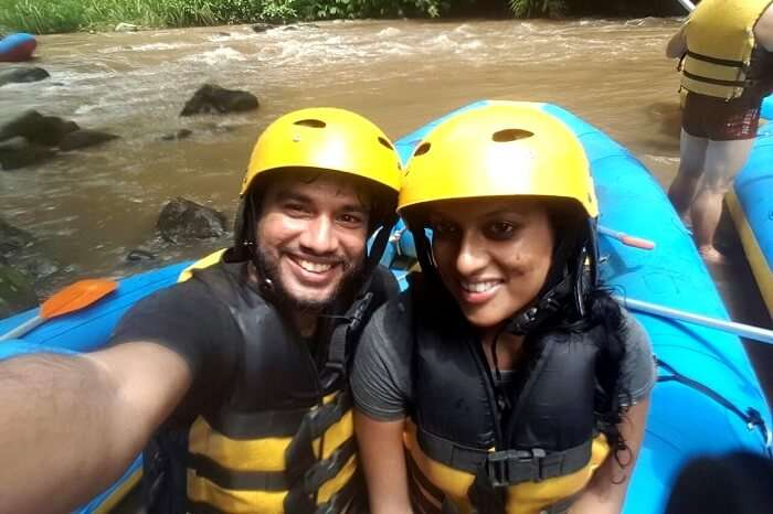 Couple enjoying river rafting