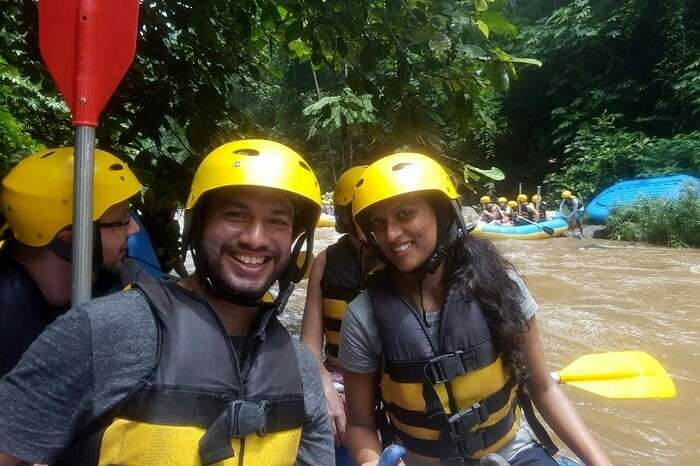 Couple engaging in river rafting