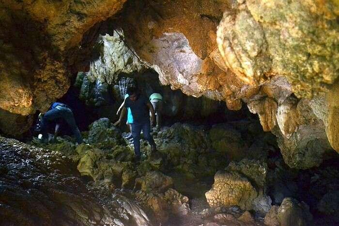 A tourist walks through the Mawsmai Caves in Meghalaya