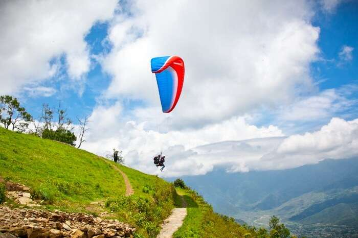 Paraglider jumping off a cliff in Khajjiar