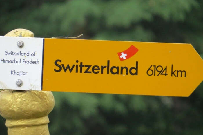 Signboard showing Khajjiar as Switzerland of Himachal Pradesh