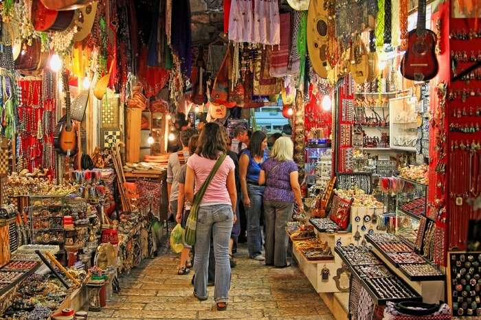 Travelers exploring the souvenirs shop at a tourist spot