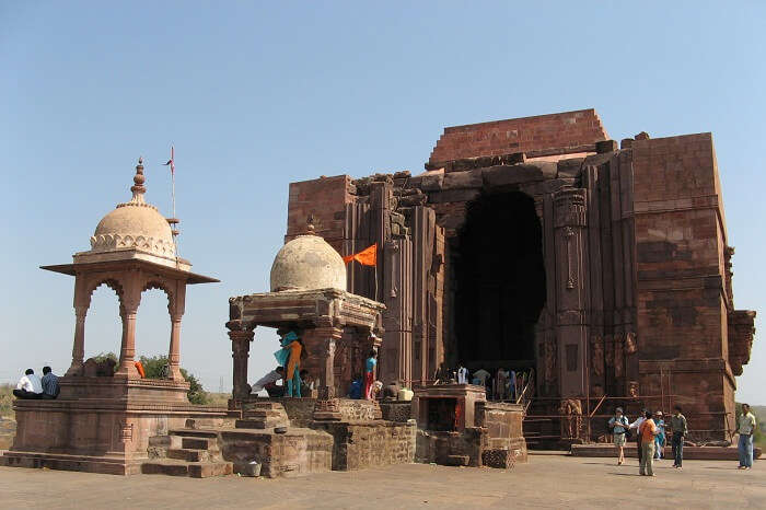 Tourists exploring the ancient Bhojpur Temple that is a highlight of the Bhopal tourism