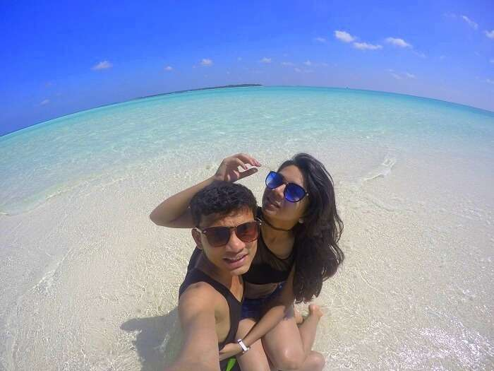 Nisarg and his wife chilling on a beach in Maldives