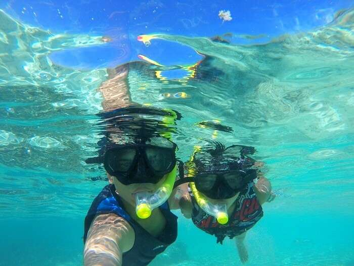 Nisarg and his wife snorkeling in Maldvies