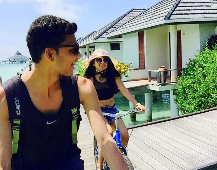 Nisarg and his wife having a good time cycling at their resort in Maldives