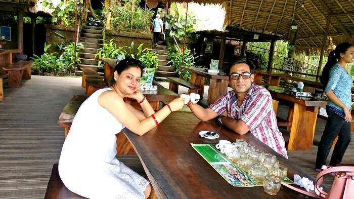 Couple drinking coffee at a coffee farm