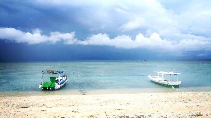 Speedboats on the white sandy beach