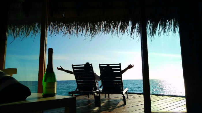 kishor & wife chilling in their water bungalow in maldives