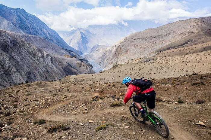 A tourist goes for mountain biking in Nepal