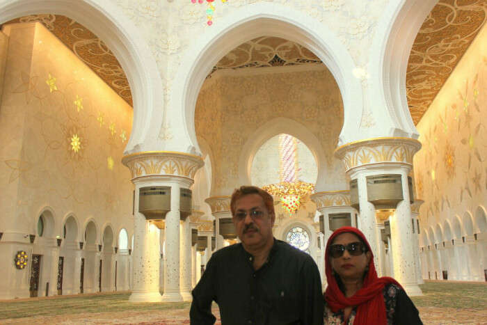 Standing under the eminence of the Sheikh Zayed Mosque