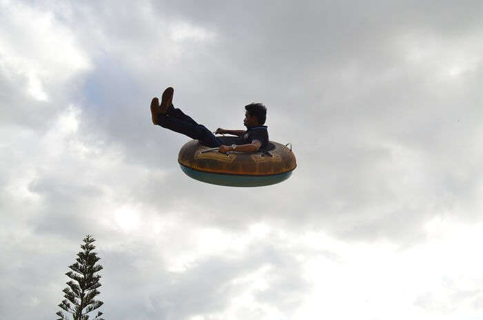 Man enjoying a flying tube ride in Mauritius