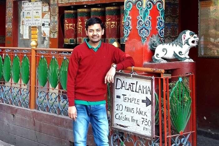 A traveler posing outside Dalai Lama temple in Mcleodganj