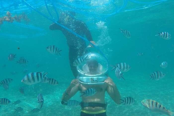 Man enjoying under seawalking in Mauritius