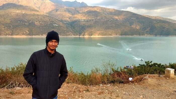 Rishabh poses for a picture at the Tehri lake