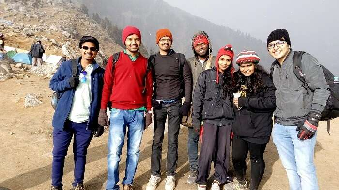 Group of friends trekking on a montain