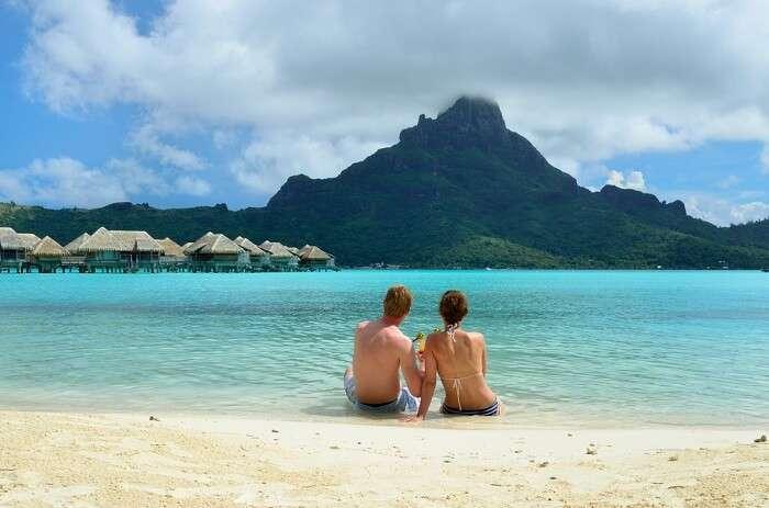 Honeymoon couple on Bora Bora beach