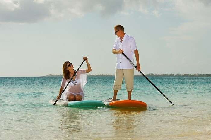Paddle surfing couple in Grand cayman