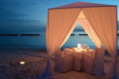 Romantic dinner set up on a sea beach in Sri Lanka