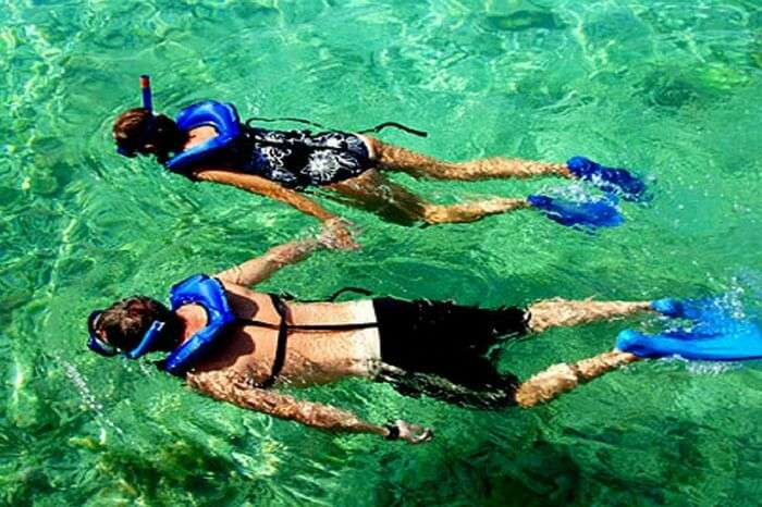 Couple enjoying snorkeling session in Sri Lanka