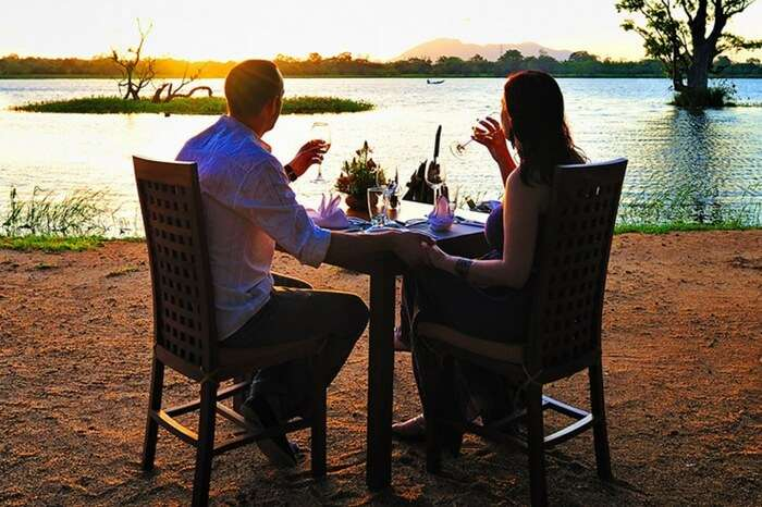 Couple enjoying a romantic dinner at a resort in Sri Lanka