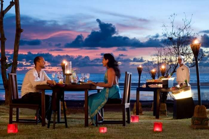 Couple enjoying a romantic dinner by the sea beach in Sri Lanka