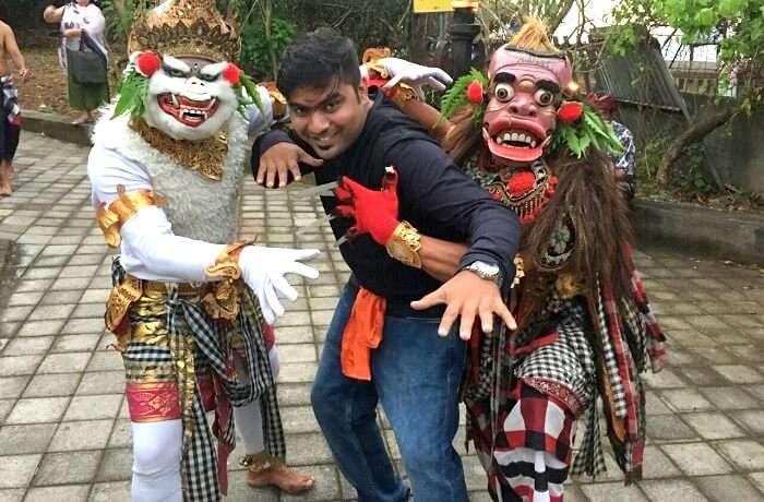 Man with masked dancers Bali