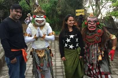 Couple with mask dancers in Bali