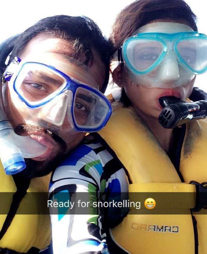 Mubashir and his wife in their snorkeling gear