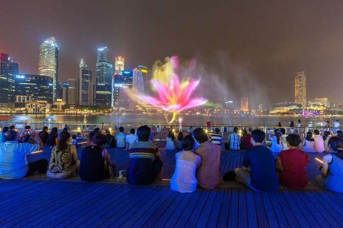 People watching the light & water show at Marina Bay Singapore