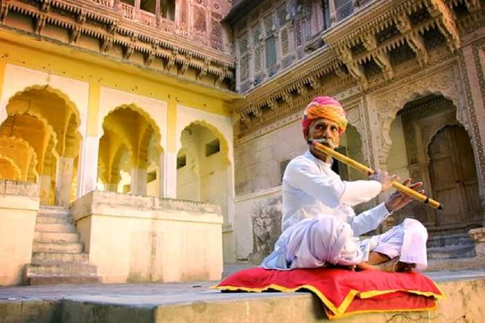 A flautist playing outside Jodhpur Fort
