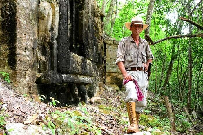 An archaeologist at the excavation site of the Maya city of Lagunita