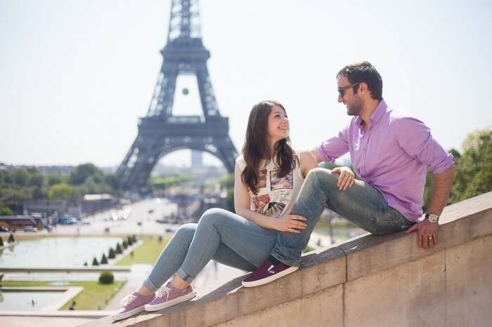 Honeymoon couple in Paris with Eiffel Tower in the backdrop
