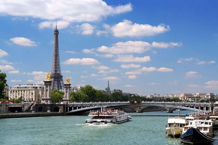 Cruise boat on the Seine under Alexandre III bridge in Paris