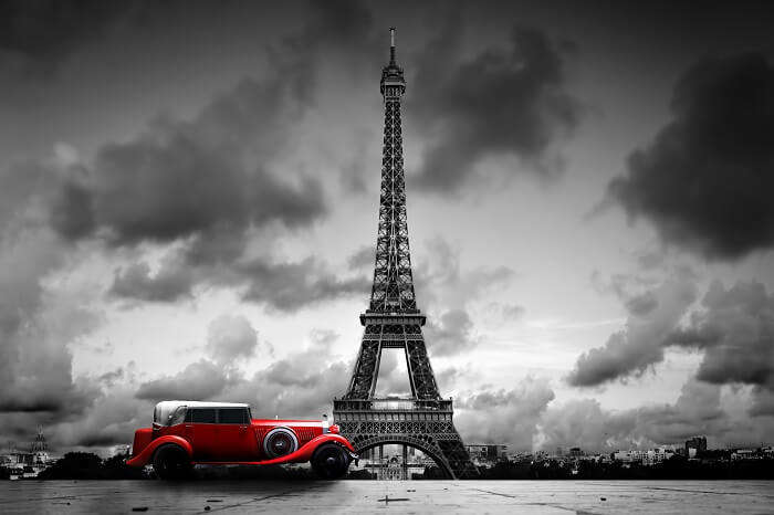 Artistic image of Effel Tower and retro car in Paris