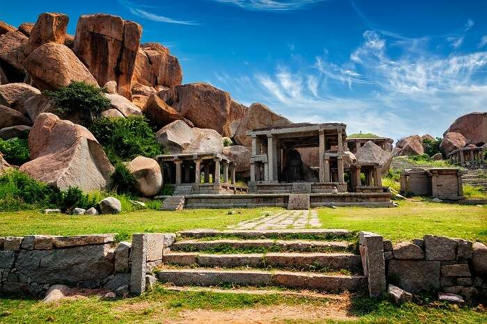 Ancient ruins in Hampi surrounded by large rocks that had kept the ancient Indian city hidden for years